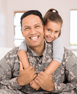 solider and his daughter in their home